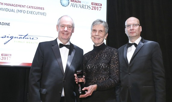 Anne B. Shumadine, J.D., Signature Founder and Chairman, accepts award in 2017 from Wealth Report New York.